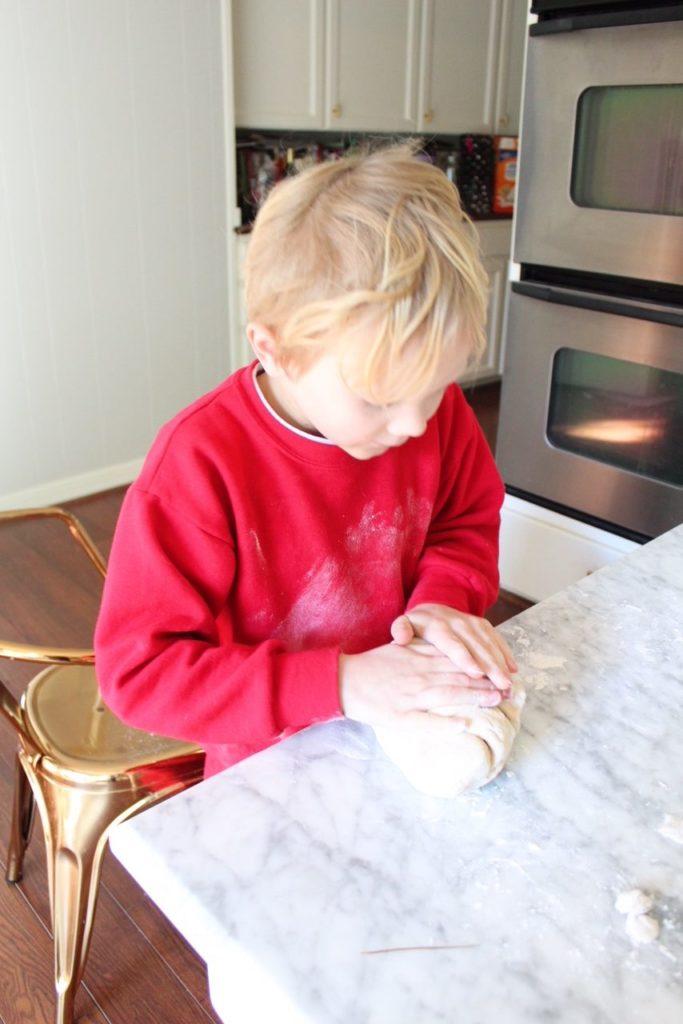 Kid cooking in kitchen