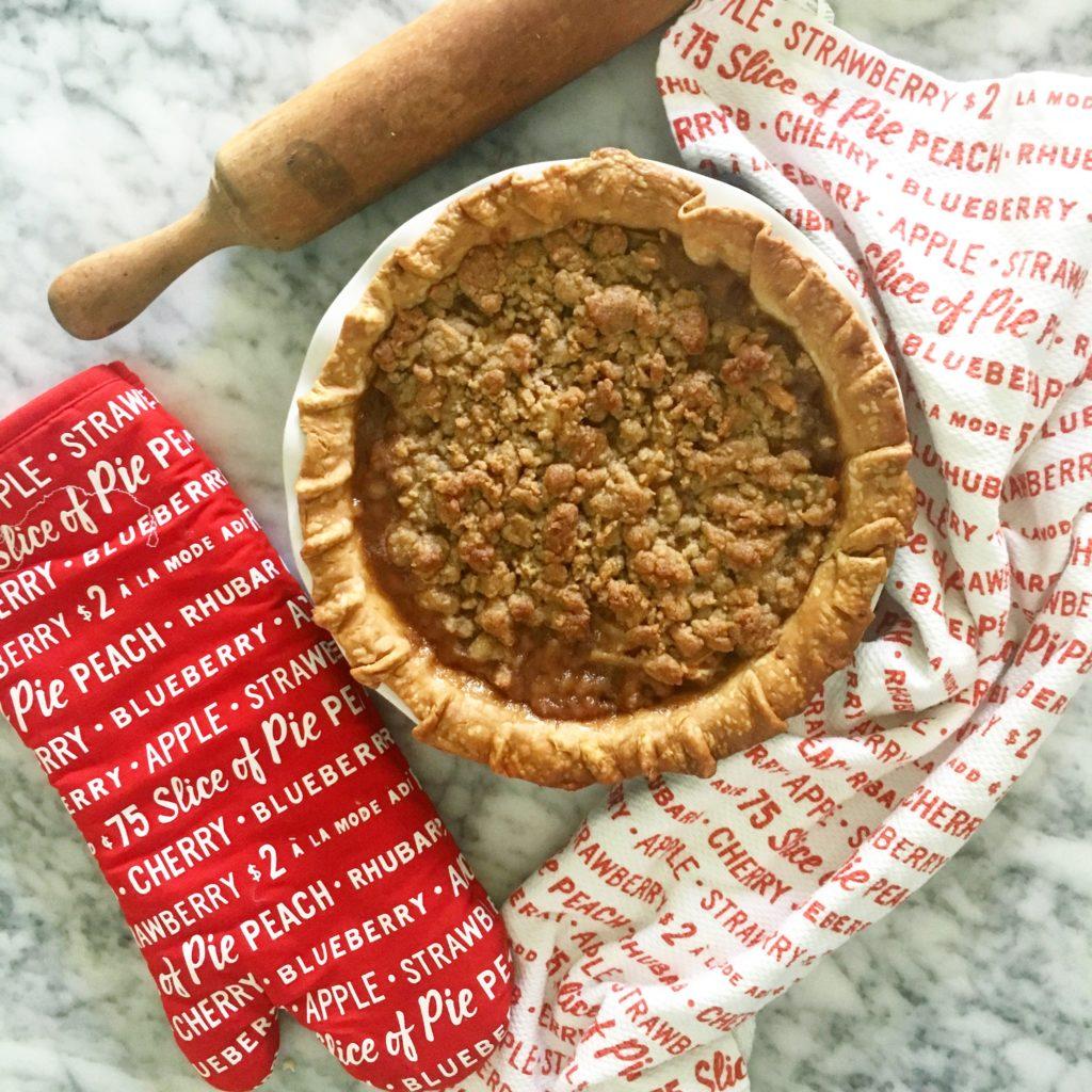 Pie, dish towel, rolling pin