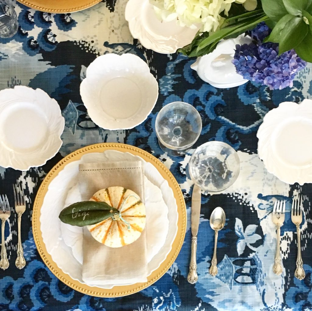 Table setting for Thanksgiving with pumpkins